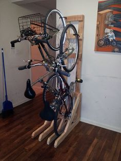 Vertical Bike Rack from 2x4s - space saver and you don't have to put holes into your wall. Probably will modify for my uses.