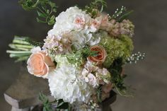peach bouquet with wedding flowers like veronica, stock, and tea roses, Dallas wedding flowers by AntebellumDesign.com
