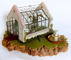 """English Greenhouse"" - Lady Jane Glass Display Case. Half-inch scale: $950 8"" Wide x 9 Long x 8"" High. Contents sold separately. Also available in a larger size: 18"" W x 17"" D x 18"" H Price: $2,200"