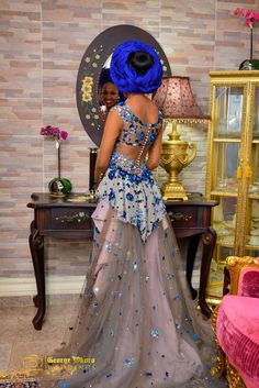 Stunning illusion back, created with beads.