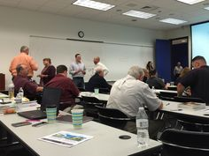 Faculty and Executive Students chatting before the last session of the week.