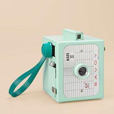 mint green vintage camera. @Gabriella Denizot Denizot Gorby Kisses