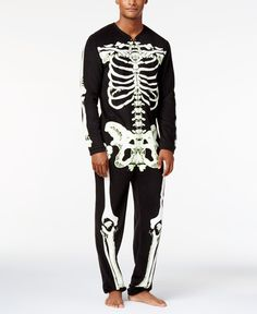 Offering a glow-in-the-dark skeleton design and warm faux fleece, this onesie costume from American Rag helps keep your look spooky and warm for your night of fun. | Faux fleece: polyester exclusive o
