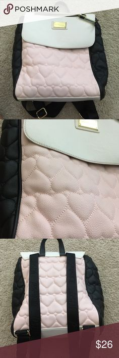 Betsy Johnson backpack! Pink and black Betsy Johnson backpack 🎒. In great condition. Pink and black hearts stitching.  Adjustable straps and gold hardware Betsey Johnson Bags Backpacks