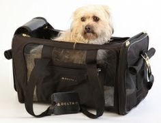 Sherpa Delta Deluxe Pet Carrier | The Delta Deluxe features top and side entry, a side pocket for storage, roll-down privacy flaps, mesh panels for ventilation, locking zippers, padded hand-carry straps, an adjustable, no-slip shoulder strap, a seatbelt / luggage strap and a Delta luggage tag. Find it at TripsWithPets.com.  #airlineapprovedpetcarriers