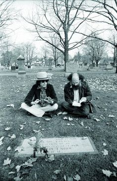 Bob Dylan and beat poet Allen Ginsberg sitting at Jack Kerouac's grave in 1975.