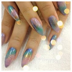 tthuyynguyen:  Mermaid Nails! Have you guys seem the two tone nails? Well, these nails are the same concept but I tweaked them a bit. I used 3 color and a gold glitter for this effect. The colors looked a lot better in real life than in this picture. I hope you guys enjoy it!