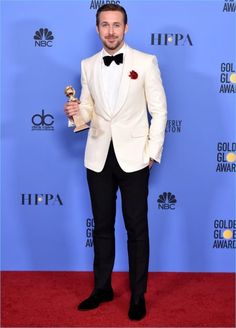 January 2017: Ryan Gosling poses for pictures at the Golden Globe Awards, where he won for Best Musical or Comedy. Gosling wears a custom white tuxedo jacket and pants by Gucci.