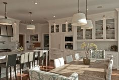 We love how open this #kitchen is. The combination of an eating area and cooking area is an interesting concept. http://budgetbathandkitchen.com/
