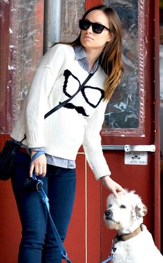 We love that Olivia dresses with a sense of humor, even while pregnant. She was spotted wearing this fun sweater while walking her dog, Paco, in NYC.