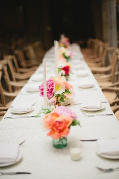 Love the small simple flower arrangements on the long table