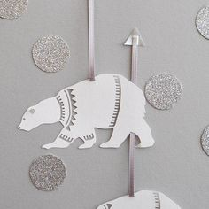 A set of six shimmery white die cut paper polar bears, which can be used as hanging decorations or cute gift tags!    Each polar bear is cut