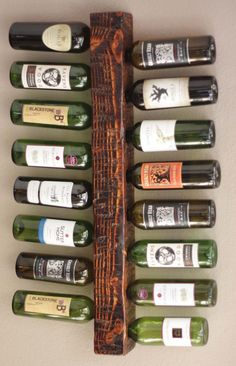 Wood Wine Rack display holds 16 FULL bottles of wine safely and securely. Ive made this wine rack completely by hand of a single piece of pine. I