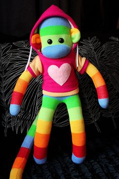 Rainbow Sock Monkey! Oh YES please!  I love sock monkeys and have a handful of them... I want more!