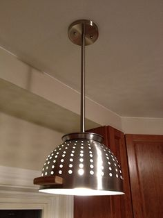 OOOH - great idea!  maybe with my little strawberry colander????    Colander Ceiling Light. $69.00, via Etsy.