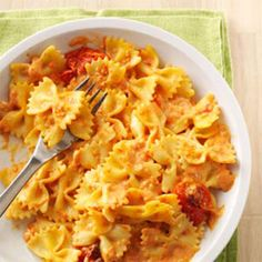 Pasta with Roasted Garlic & Tomatoes Recipe -Here's a simple sauce with just four ingredients, and it's savory enough for a fancy party. I use bow tie pasta, but penne works, too. — Aysha Schurman, Ammon, Idaho