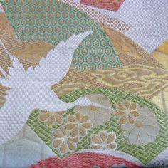 obi with white crane
