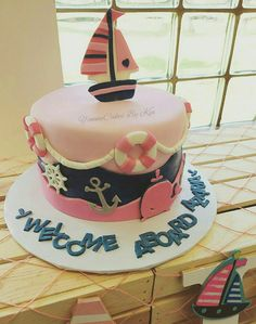 "Nautical pink girl baby shower cake  ""Welcome Aboard """