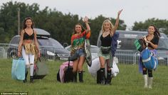 Excited: Revellers were seen carrying sleeping bags and tents as they arrived ready to cam...