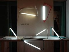 light fixtures for wall, floor or table made of bent metal rods joined by an acrylic tube that houses about 120 LEDs