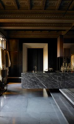 everything about this bathroom is so seductive - from the statement marble sink to the mood lighting + detailed ceiling...