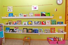 Love this Rain Gutter book shelf with hanging gallery above it and room for toy biuns below.