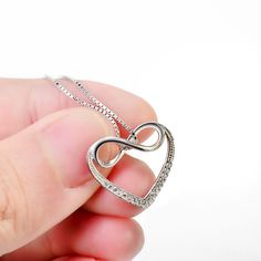 *** Buy 2 Items Get 1 Free ***  ***FREE FAST SHIPPING*** (usually delivered within 48h-72h) Get this awesome Infinity Heart Necklace now! Material: 925 Sterling