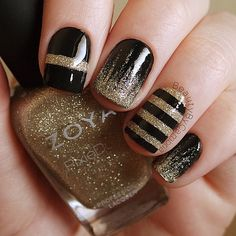 Black and gold nails using Zoya Tomoko and OPI Black Onyx with a thick coat of Seche Vite Top Coat. Stripes were done with black acrylic paint. - Black Onyx and Seche Vite are from @hbbeautybar and Tomoko was a gift ❥CP