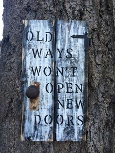 I love this one.  Made from painted and sanded pallet wood.   Kenny attached the hinge, key plate and rusty doorknob for me.