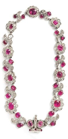 Antique Ruby and Diamond Necklace, set with thirty-three oval to cushion-cut rubies including two cabochons, ranging in size from approx. 9.70 x 8.10 x 3.40 to 2.10 x 2.00 mm, and old mine-cut diamonds, the clasp designed as a coronet with rose-cut diamonds, and converting into a pair of bracelets, total lg. 13 3/4 in. #antique