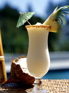 Piña Colada  2 ounces light rum 2 ounces pineapple juice 1 1/2 ounces cream of coconut Pineapple wedge for garnish Maraschino cherry for garnish