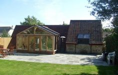Fossil Barn is a high specification barn conversion with a centrepiece hand built oak and glass fronted living area. The large fully enclosed garden to overlook from the impressive lounge Living Area, Fossil, Gazebo, Shed, Barn, Lounge, Outdoor Structures, Portland Dorset, Luxury Cottages