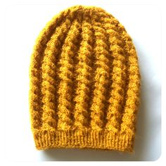 knit hat with ropey cables