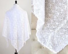 Elegant antique Irish lace shawl, very generously sized. This shawl features a beautiful, and finely worked pattern of flowers, leaves and