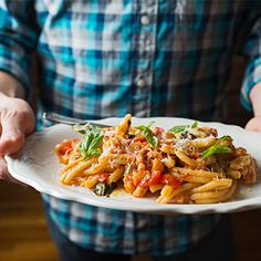 Pasta Alla Norma by Rucola Chef Joe Pasqualetto , tastingtable: the classic Sicilian recipe for pasta in tomato-eggplant sauce, spiked liberally with garlic and fresh basil and topped with a dusting of hard, salty cheese. #Pasta #Tomato #Eggplant #Garlic