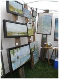 Art Display Systems for Art Festivals - old barn board or painted boards with pegs screwed in to display canvases or works of art. - love!