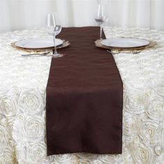 Chocolate Polyester Table Runner   Plan as many events as you want and invite as many guest as you desire without even worrying about the expenses and your budget. With our sturdy and economical polyester table runners, you can now transform any dining experience into a magnificent feast with an upscale feel and an elite look without breaking the banks. Get inspired by this premium quality polyester table runner that opens the gates of creativity and ingenuity. With such a high standard…