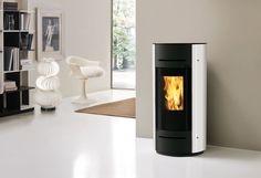 Edilkamin Ania fireplace- Edilkamin Ania kandalló Hermetic pellet stove with white or black glass cover, ideal for any living space and modern passive houses. Fireplace Doors, Fireplace Cover, Gas Fireplace Logs, Fireplace Glass, Gas Fireplaces, Steel Doors And Windows, Pellet Stove, Passive House, Types Of Doors