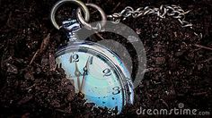 Conceptual photo of a vintage clock buried in the ground.  #dreamstime #photography #oldclock #vintage #lost #treasure #jewelry #jewels