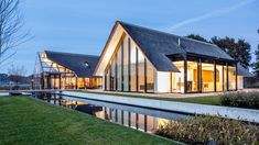 """This beautiful countryside villa was designed by Netherlands-based firm Maas Architecten. """"The villa is located in an open countryside and is designed as a H-shape. Architecture Baroque, Architecture Design, Green Architecture, Villas, Mirror House, Thatched Roof, Building Design, Exterior Design, Cottages"""