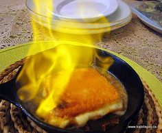 Saganaki... Greek fried cheese, flambéd. Great served with warm soft pita, a Greek salad and a glass of good red wine!