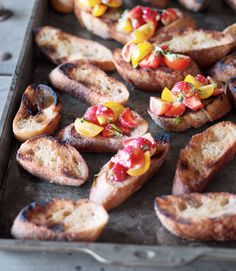 """""""Grilling bread brings out its best qualities,"""" said Allen, who slathered slightly charred slices of baguette with a sweet-savory mix of strawberries and cherry tomatoes. Recipe: Bruschetta with Strawberries and Tomatoes   - CountryLiving.com"""
