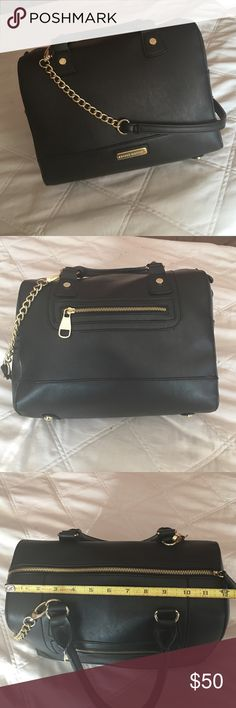 Bowler bag Steve Madden black and gold bowlers bag. 12 inches across 11 inches tall and 7 inches deep. Like new condition. Barely used. Functional outside zipper, lined with black and white chevron Steve Madden Bags