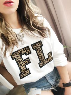 Annie Young from Something About Navy wearing Leopard Florida Sweatshirt