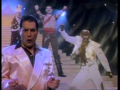 Freddie Mercury-The Great Pretender (1987) ~ This extended video, directed by David Mallet, accompanied Freddie Mercury's 7th solo single release, in 2/1987. Using rushes from the filming, the video perfectly captures the fun and frolics that Freddie and everyone around him enjoyed while recording this video. The two 'lady' backing vocalists are none other than Freddie's good friends Peter Straker and a certain Mr Roger Taylor, from a band called Queen. The single released in UK 23/Feb 1987