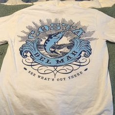 """Costa S White TShirt EUC white """"Costa"""" tshirt; blue """"C"""" insignia on front left chest; large swordfish design on back; 100% cotton; previously washed so no shrinkage to worry about. Fits TTS. Costa Tops Tees - Short Sleeve"""