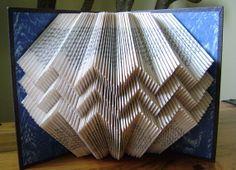 Folded book art ,chevron, Southwestern ,upcycled book art by Dancing Grey Studio.