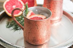 Grapefruit-Rosemary Mule:  2 oz pink grapefruit, ½ oz lime, 3 oz ginger beer, 1 sprig rosemary.  Muddle rosemary for extra flavor.  Serve on the rocks in regular glass/copper mug, or chill and pour in sugared martini glass.  Garnish with rosemary and/or grapefruit (optional).  Makes 1 serving