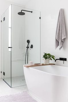 Nothing beats a clean, simple bathroom design. Nothing beats a clean, simple bathroom design. Steam Showers Bathroom, Laundry In Bathroom, Bathroom Renos, Bathroom Inspo, Shower Tub, Bathroom Renovations, Bathroom Inspiration, Bathroom Ideas, Bathroom Bin