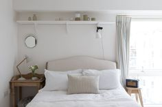 shelf, headboard, clip on light fixture, stool as bedside table, radio, stripped wood bedside night table (DIY inspiration shade of wood)